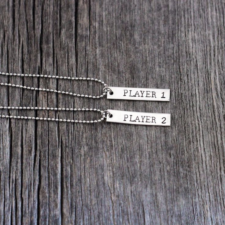 Player 1  Player 2 hand stamped couples necklace set / couple's necklaces / gamer necklace / video game necklace / nerd couple necklaces by FireflyLaneStamping on Etsy https://www.etsy.com/listing/244144633/player-1-player-2-hand-stamped-couples