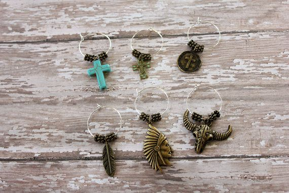 Toast your friends in style with these fun, southwestern-inspired wine charms! This set of six will stylishly ensure your guests dont mistake anothers glass for theirs. And who doesnt love turquoise?!  Ready to ship!  »»»»»»»»»»»»»»»»»»»»»»»»»»»»»»»»»»»»»»»»»»»»»»»»»»  View more of our mother/daughter handmade items here: http://www.BuckskinBetty.Etsy.com  Follow us on Facebook at https://www.facebook.com/BuckskinBettyLLC Follow us on Instagram at https://instagram.com/BuckskinBetty Follow…