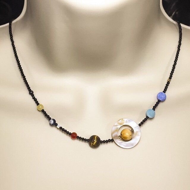 NEW Solar System necklace - onyx, tigers eye, jasper, sodalite, moonstone, topaz, hematite, shell - Planets, Sun, Moon, Mars, Venus, Pluto by ISpyWithMyBeadyEye on Etsy https://www.etsy.com/uk/listing/473789561/new-solar-system-necklace-onyx-tigers