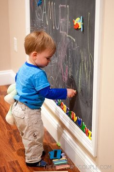 """Double duty chalkboard/magnet wall. Paint it on and then """"frame"""" it."""
