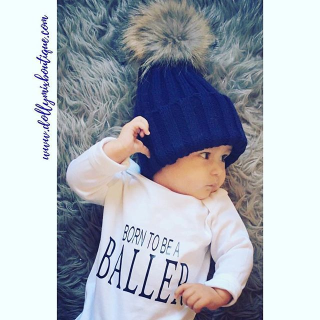 Born to be a BALLER ⚽️ Otis even has his pose on point 👌🏽 Love this Babygrow teamed with our Navy Blue Luxury Fur Pom Pom Hat. Both items in stock >>> www.dollymixboutique.com 💙