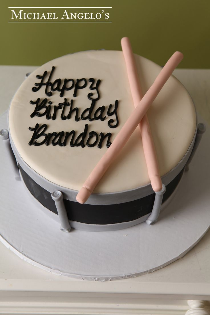 Band Drum #54Hobbies by Michael Angelo's Bakery | This single drum is ideal for a student who plays in the school band or for anyone who just enjoys banging on their drum all day! The entire cake is iced in fondant and has details around the ends to make it look like a real drum. The drum sticks are all fondant.