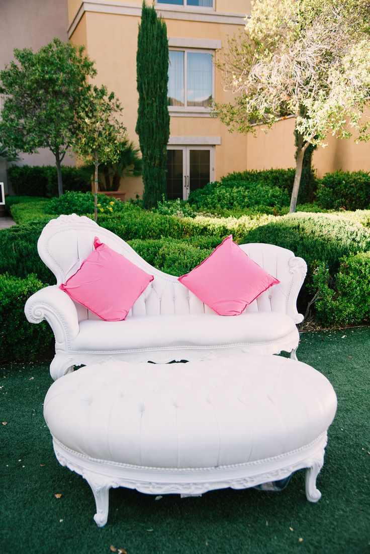 Gorgeous white furniture with pink pillows for an outdoor wedding reception (Ivan Diana Photography)