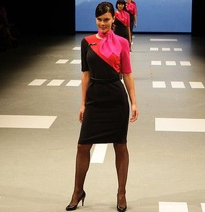Love the new Qantas uniform. Love the block colours, love the red soles of their heels (very Louboutin-like).