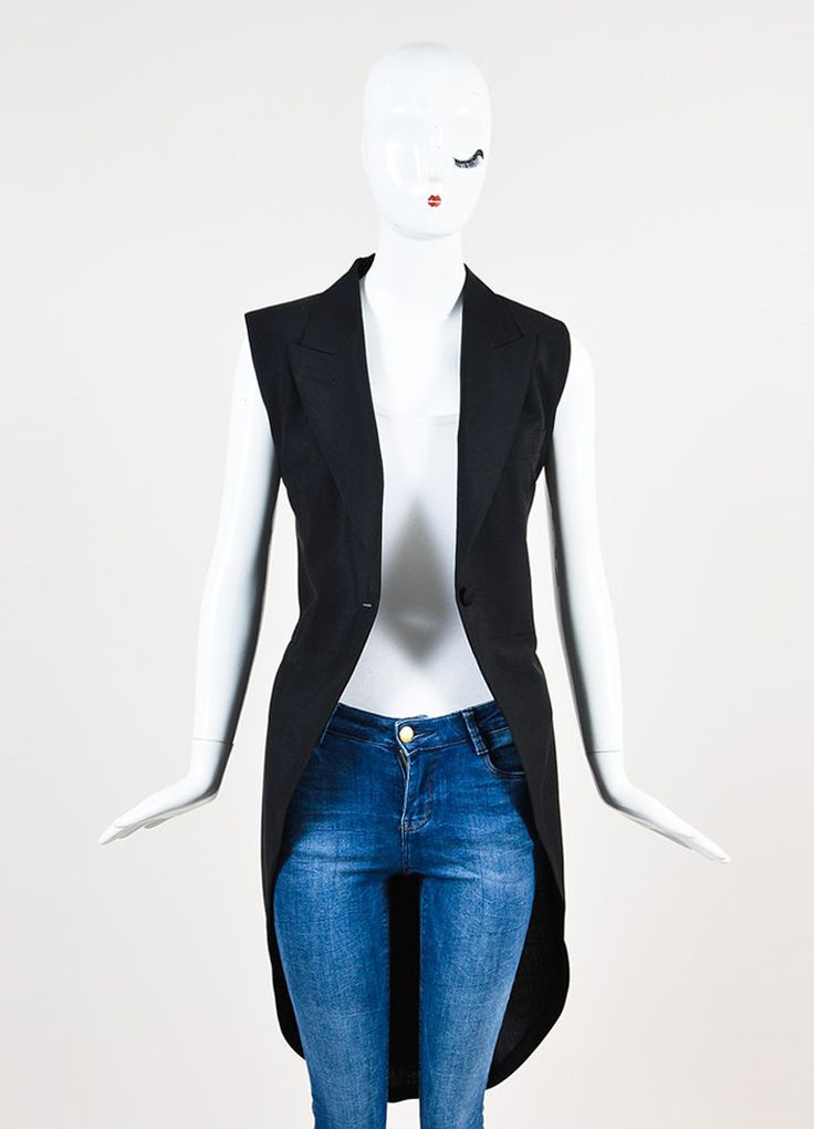 Maison Martin Margiela black wool tuxedo vest featuring long tails, peak lapels, and ties at back waist. Sleeveless. Shoulders are lightly padded. Vest is partially lined. åÊ Size: 40 Made in: Italy C