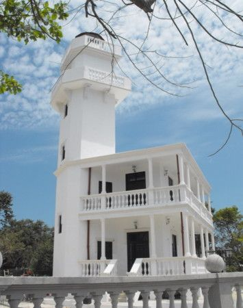 Faro de Isla Aguada Mexico. 1908. Inactive (a decorative light is displayed). 20 m (66 ft) square concrete tower with lantern and double gallery, rising from one corner of a 2-story concrete keeper's house.