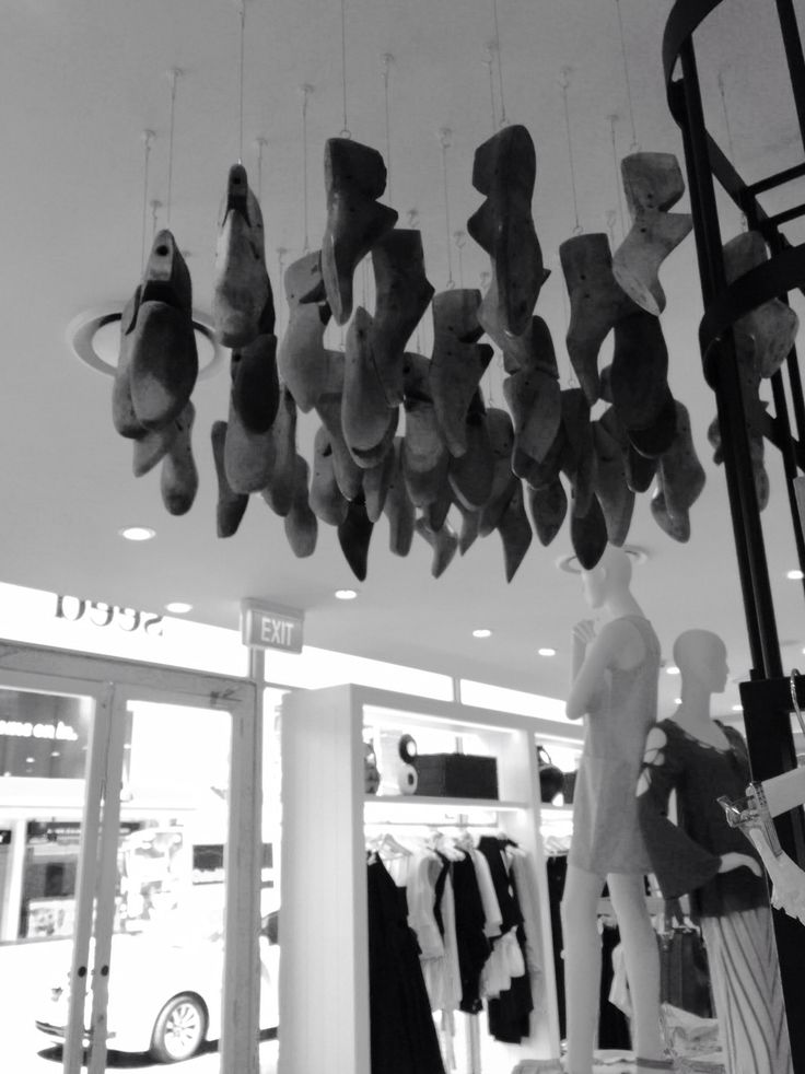 Old wooden shoe forms hang from the ceiling in Seed, Newmarket