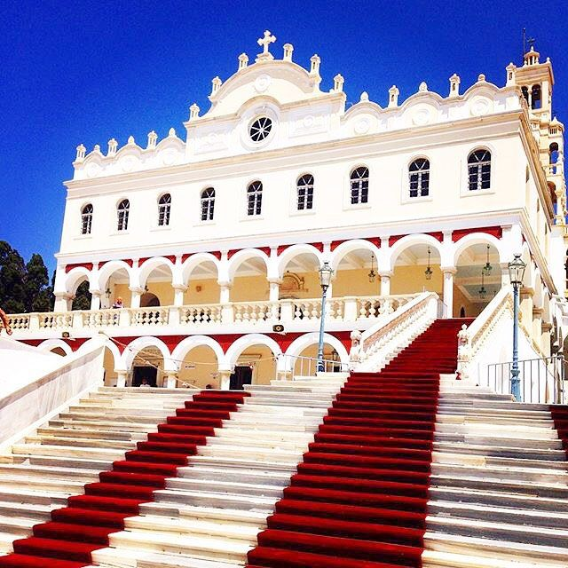 The church of Panagia Evangelistria is the declared national patron saint of Greece , at Tinos island (Τήνος) . The 15th of August is a day devoted to the Dormition of Virgin Mary .