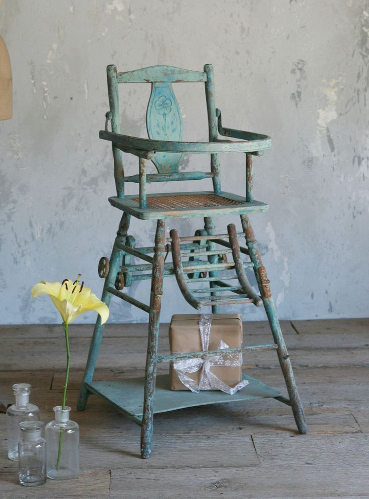 Vintage highchair... Eloquence, Inc. Very cute, but I think I'd be scared to actually put my child in it.