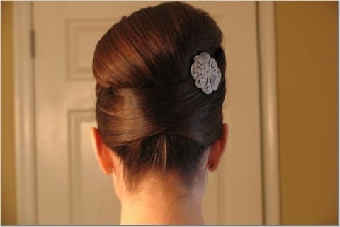 updo. I wear my hair in a messy bun 5 days a week. Maybe I should learn something like this.