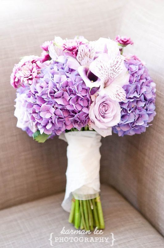 Love the flowers in this bouquet. Stunning color. | Wedding bouquet, purple hydrangeas and purple roses