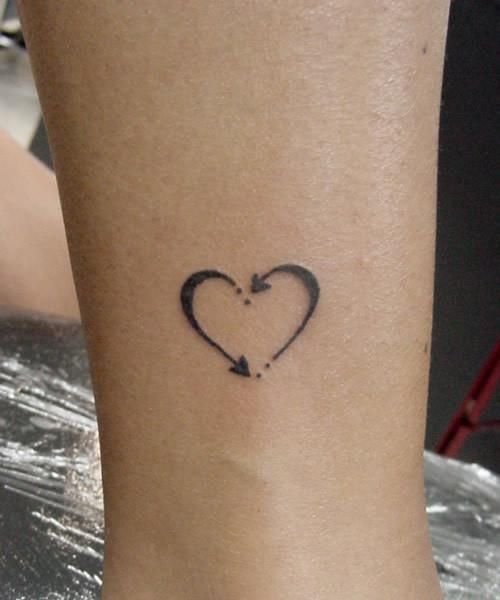 Heart tattoo - two people, when one starts to loose hope the other steps in to keep the love alive ♥