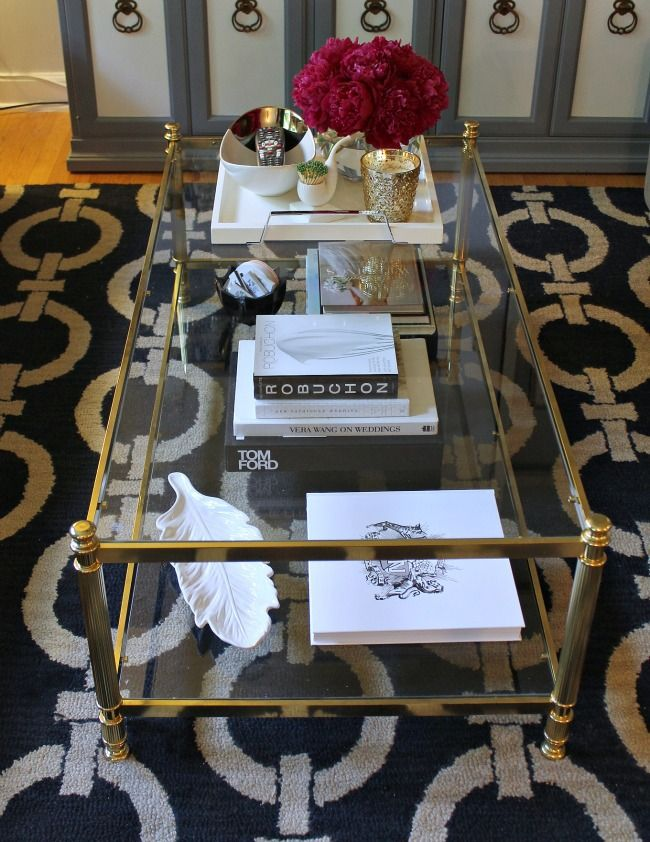 mint love social club: {gold + glass coffee table} Love the black and cream rug