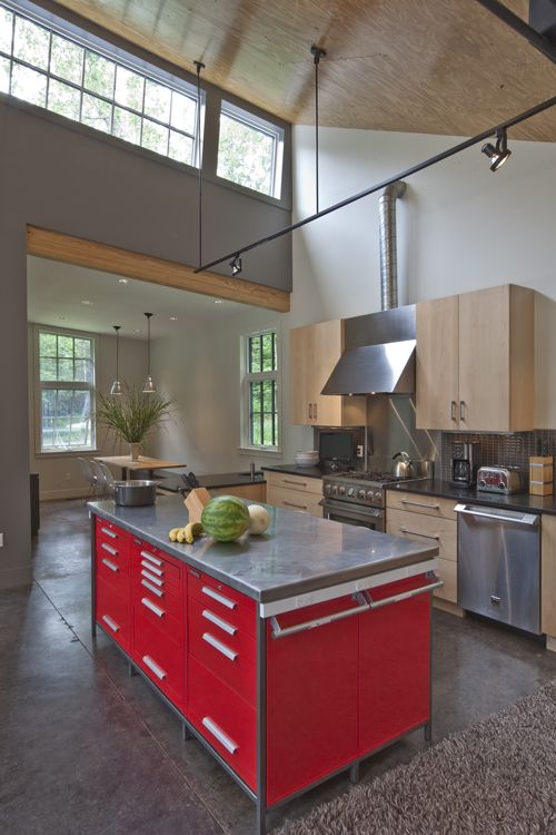The red kitchen island was devised from six off-the-shelf toolboxes, contained in a custom steel frame. (Burr & McCallum)