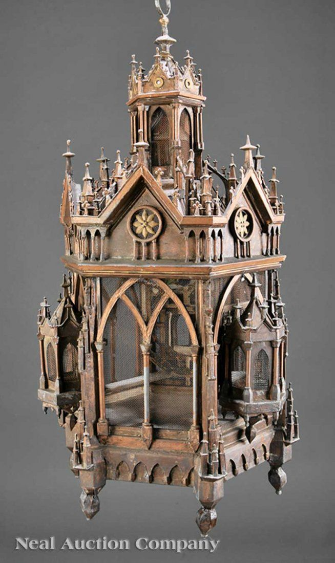 An American Gothic Patinated Metal Hanging Birdcage, mid-19th c., hexagonal form modeled as a highly detailed cathedral lantern, fitted with screens,