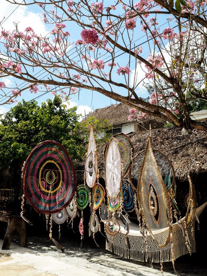 On our way to Coba we passed so many amazing, intricate dream catchers for sale that we asked our driver to stop on the way back. They're by far the nicest dream catchers I've seen (like the one we had hanging above our bed at Sanara) and we stopped at a really sweet, family-run stall next to a blossom tree. We chose a plain white, medium-sized dream catcher that survived the rest of the journey and is now hanging proudly above my bed.