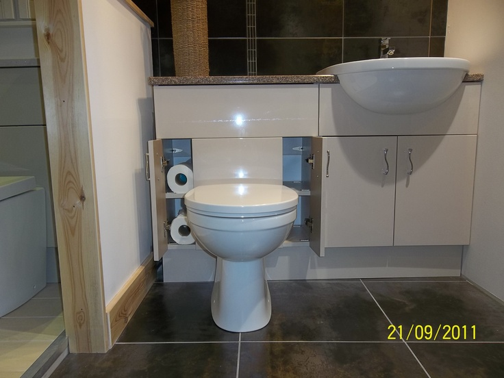 Our toilet unit is unique in that it provides, via the small doors, easy access to the cistern AND additional storage.