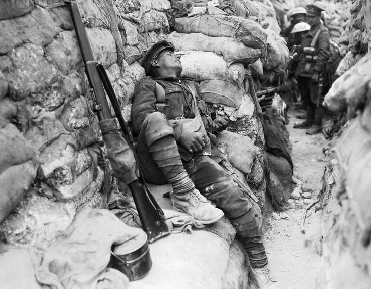 MINISTRY INFORMATION FIRST WORLD WAR OFFICIAL COLLECTION (Q 1071)   The Battle of Thiepval 26-28 September: An exhausted soldier asleep in a front line trench at Thiepval.
