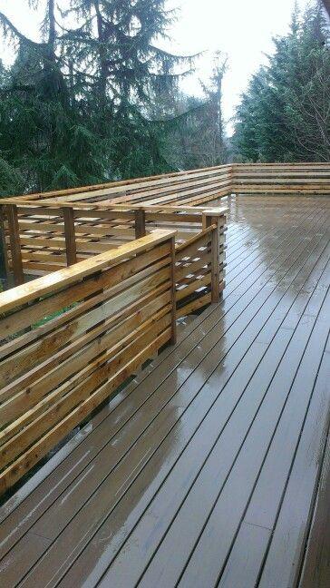 Deck build horizontal railing with Timbertech decking hidden fasteners.