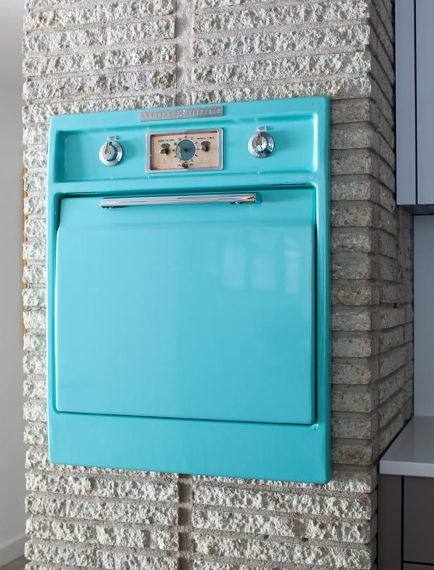 With its bright turquoise hue, the home's original GE oven is just as fashionable today as it was a half century ago.