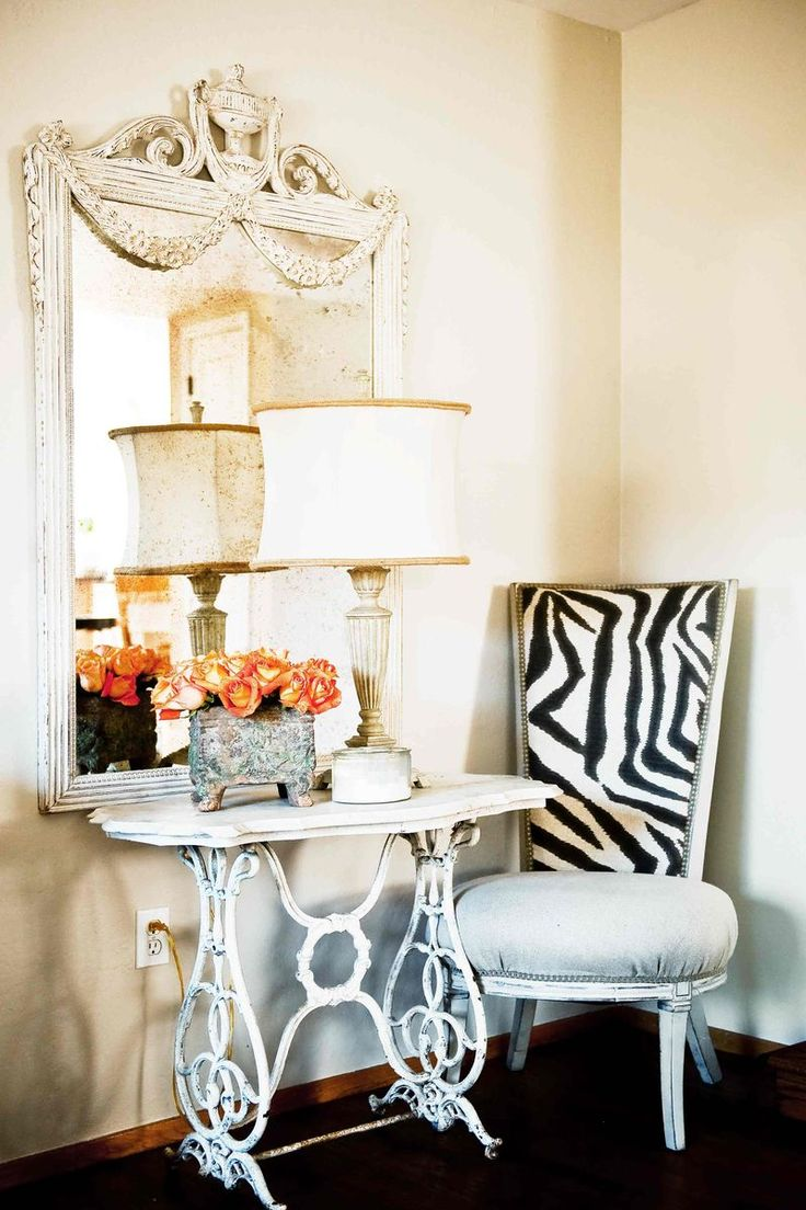 Zebra chair, orange roses, vintage mirror, antique marble pastry table