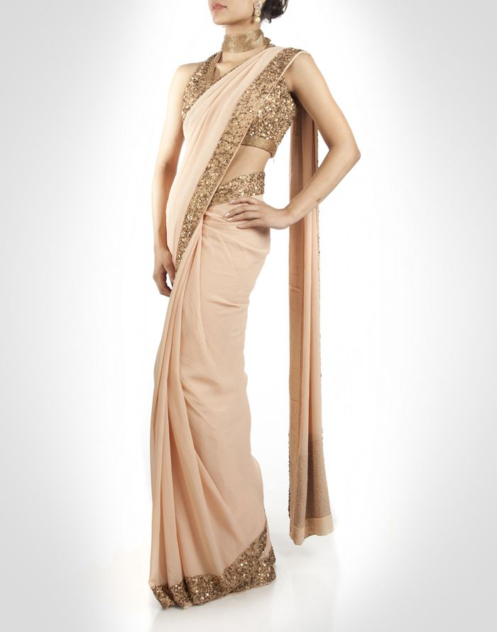 Beige sari with sequin work and high neck blouse. Shop Now: www.kimaya.in