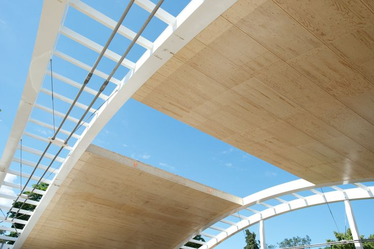 he roof elements fit flush with the vaulted, spaced, bowstring steel truss. To get the steel element the same depth as the Kerto LVL elements (645 millimeters), the steel manufacturer was heavily involved. Image by Metsä Wood UK