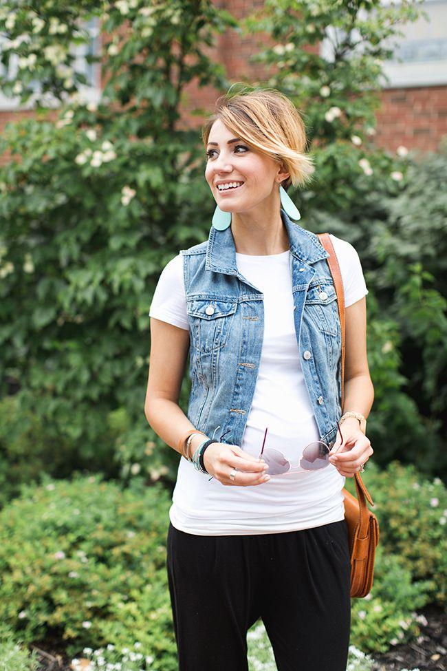 leather earrings, denim vest, maternity outfit idea