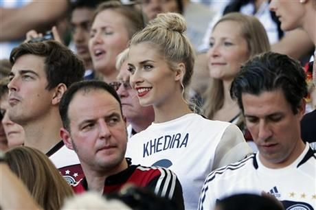 Lena Gercke, the girlfriend of Germany's Sami Khedira, waits for the start of the World Cup final soccer match between Germany and Argentina at the Maracana Stadium in Rio de Janeiro, Brazil, Sunday, July 13, 2014. (AP Photo/Matthias Schrader) ▼13Jul2014AP|Goetze scores late to give Germany the World Cup http://bigstory.ap.org/article/world-cup-final-kicks-maracana-stadium #Brazil2014 #Germany_Argentina_final