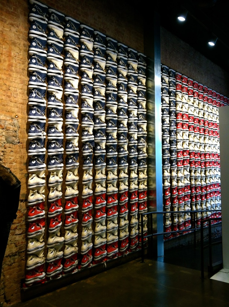 A wall of Converse Chuck Taylor shoes in the Converse store in SoHo, NYC.