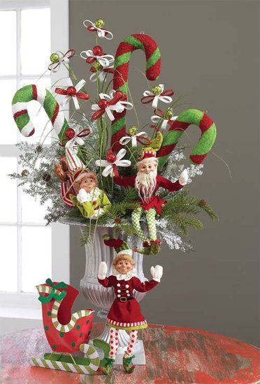 Centerpiece featuring large candy canes and elves found in the RAZ Cookie