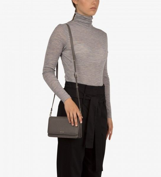"""BEE – Mini crossbody #VEGAN handbag dwell Collection Structure crossbody bag with removable and adjustable strap. Front flap with magnetic snap closure. Accordion sides. Interior: 12 card slots, 4 bill compartments, zipper coin pocket, logo-embossed Dwell tag. 100% recycled nylon lining. Dimensions: 8″ x 5″ x 2.25″ Shoulder Strap Drop: 21″-25"""""""
