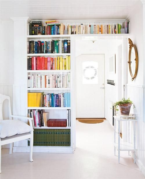 An over-the-doorway storage solution for an over-the-top collection of books.