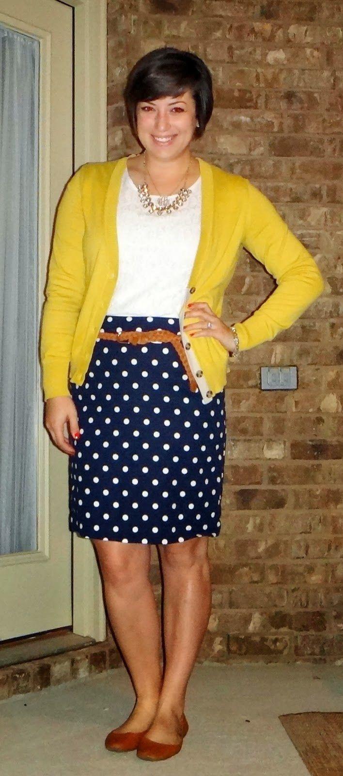 Yellow cardigan, white tee, navy skirt w/ white polka dots, lt. brown belt, brown shoes