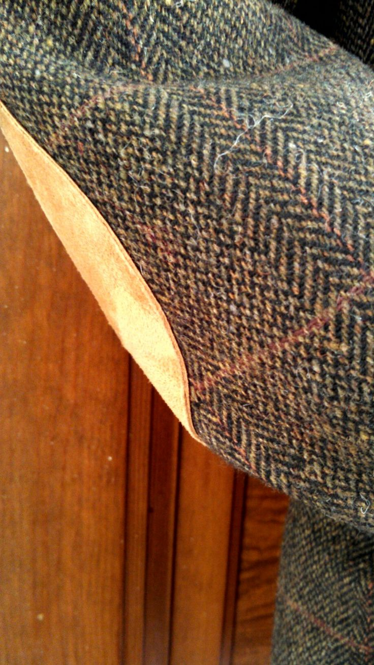 """elbow suede detail--Vintage herringbone tweed, 100% wool Evan Picone man's sport coat. Dark brown with mauve and burnt orange plaid twill. Lenght=29"""", shoulder to shoulder=20"""", chest=38"""". Two front pockets, one upper breast pocket plus one inside breast pocket. Suede patches on each elbow, and collar inner-faced with suede. Made for the upscale department store Kaufman's in Pittsburgh, PA. Available for purchase"""