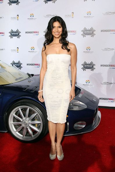 Roselyn Sanchez Cocktail Dress - Roselyn Sanchez rocked a form-fitting white ruched dress with sexy spaghetti straps at the Rally For Kids Cocktail Party in Hollywood.
