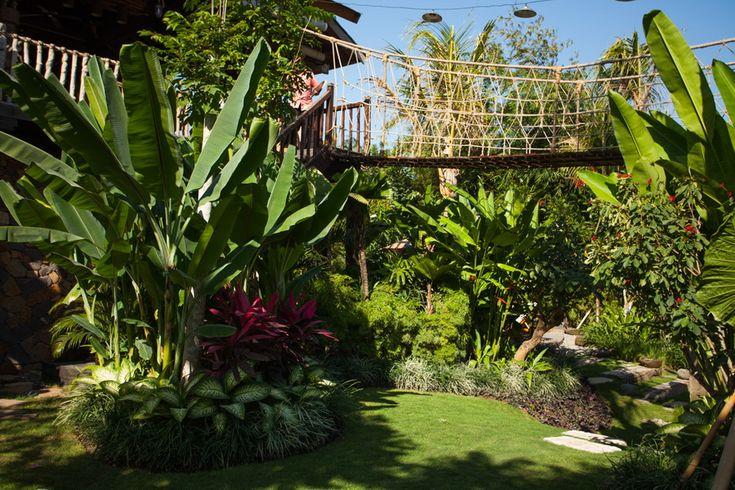 Tropical landscape design at Villa Nelayan, Bali by Bali Landscape Company  #bali #landscape #landscaping #landscapedesign #gardendesign #tropical #tropicalgarden #gardenideas #landscapeideas