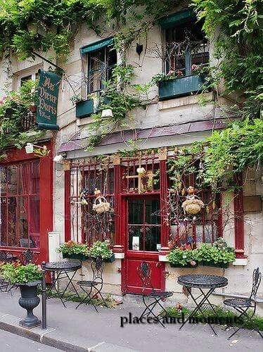 Montmartre,Paris...had a Cafe Aug Lair right at this very table while watching the artists across the street.