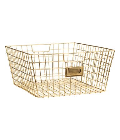 Gold-colored. Metal wire basket with handles at sides. Size 6 x 9 x 12 1/4 in.