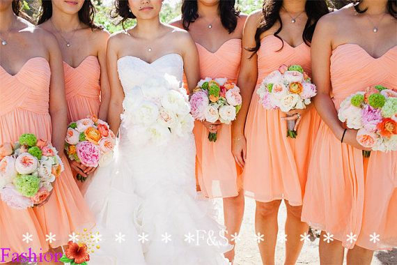 love the colour scheme. but i think the bride with orange flowers and the bridesmaids with white flowers would be so beautiful. make the dresses pop more .