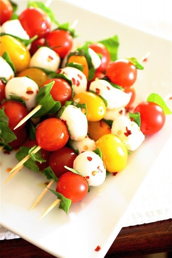 Caprese Skewers  Servings: Approximately 4-6  Ingredients  1 pint cherry tomatoes  1 pint yellow tomatoes  1 pound fresh ciliegine or other type of mozzarella cheese, fresh  1 cup fresh basil leaves, gently torn into 1/2-inch pieces  Pinch red pepper flakes, to taste  Sea salt, to taste  Extra-virgin olive oil, for drizzling  Wooden skewers, for serving