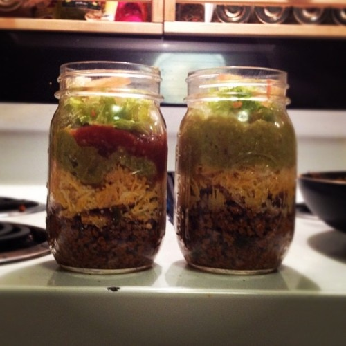 Mason jar taco salad order (bottom to top): meat/tortilla chips/cheese/tortilla chips/guacamole/lettuce/sour cream/tomatoes.