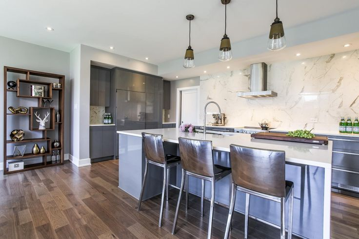 Beautiful kitchen featuring Lauzon's Natural Hickory hardwood flooring from the Émira Series. This flooring features the exclusive air-purifying technology called Pure Genius technology. Project realized by Campanale Homes.