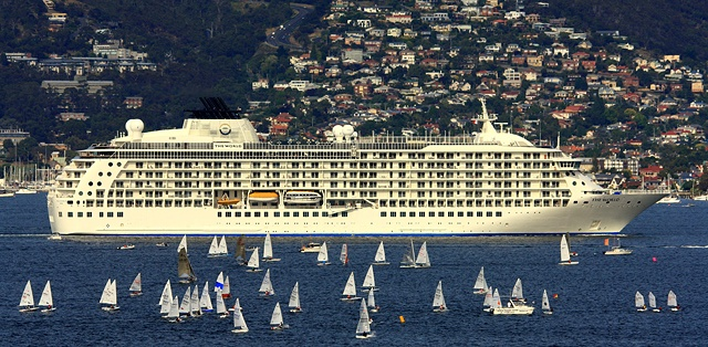 Hobart's deep harbour welcomes the largest liners - this recent photo contest winner shows the 'The World' liner arriving in Hobart surrounded by a welcoming flotilla of yachts.  Image The Mercury/Brendon Bowes