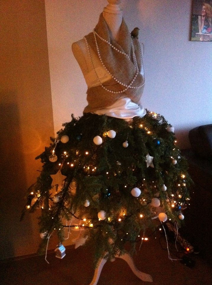 Christmas tree mannequin.   its really not that hard to make. put some strong iron wire around the waist of your mannequin. than take 15 branches, tie them up tho the wire, and decorate! #christmas #christmastree #dress #decoration #xmas #mannequin #tree