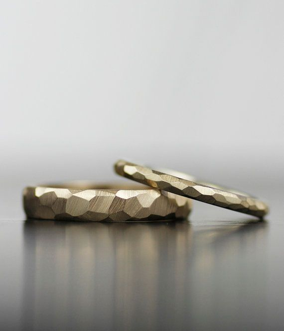 Image of faceted his or hers wedding band set