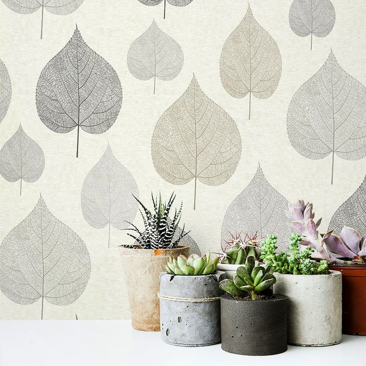 Crown wallcoverings M1070 One Leaf Natural Wallpaper Roll. Cream horizontal stripe background with large leaf design in black, brown and silver.