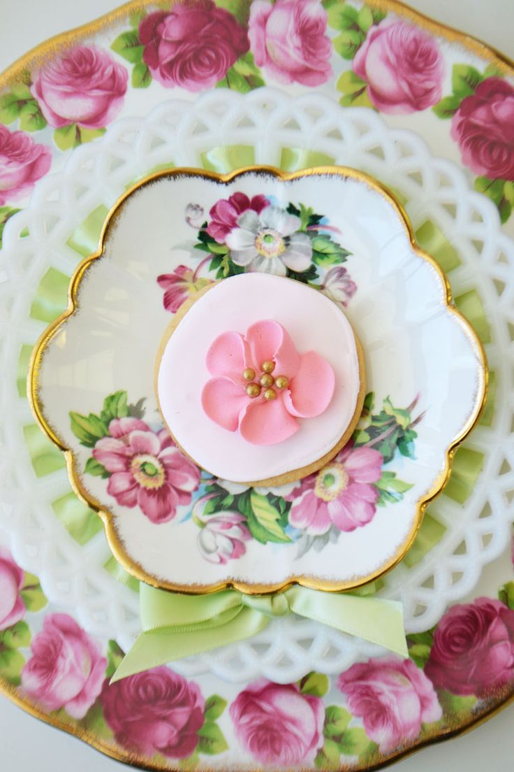 Flower sugar cookie on vintage china and mild glass plate by Bake Sale Toronto. China from Vintage Dish Rental.
