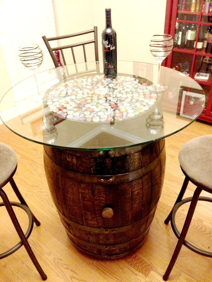 Table made from a wine barrel. I think I would like wine corks instead of the beer caps though! #thehomeything #theything