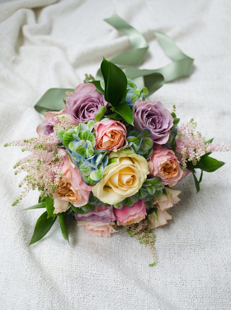 Lovely pastel bouquet.  A big bunch of roses, hydrangea, astilbe and greens.